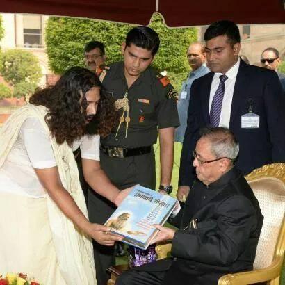 Prsenting Geeta to president of India